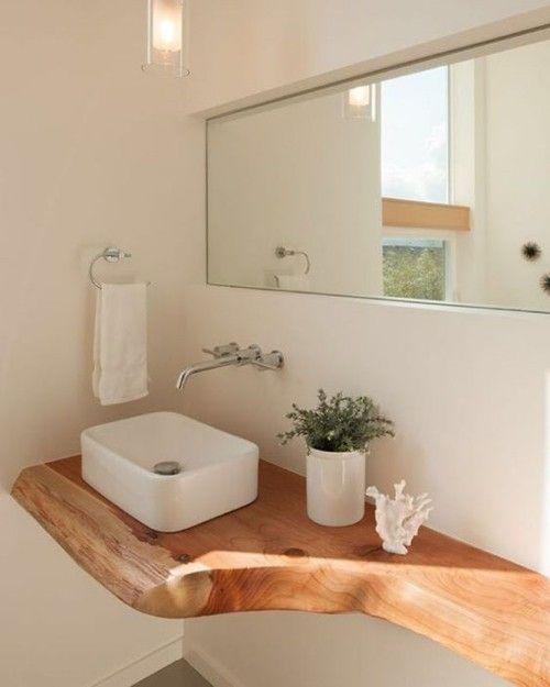 Le bois dans la salle de bain apporte opulence et chaleur, mais nécessite des soins