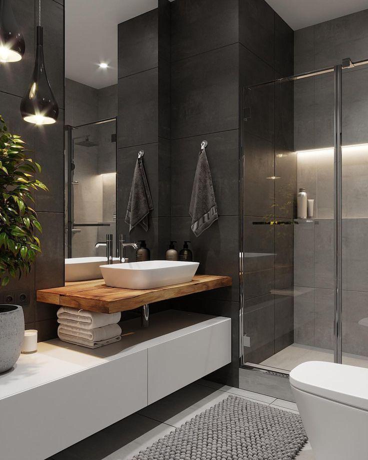 Salle de bain sombre avec douche transparente …