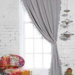 Pompons en laine pour décorer les rideaux et les coussins