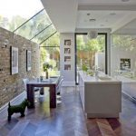 Beautiful space with custom skylight feature and herringbone wood flooring #inte