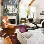Cowhide rug mixed with traditional pattern carpet – Layering rugs trend inspir...
