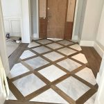 """Doro's Floors on Instagram: """"This foyer is turning out great...custom wood and tile inlay. Wood pickets with 24"""" x 24"""" tile. Sanding / staining process to start soon.…"""""""