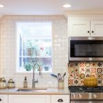 Eclectic kitchen in a historic townhouse in Jersey City featuring Fabuwood kitch...