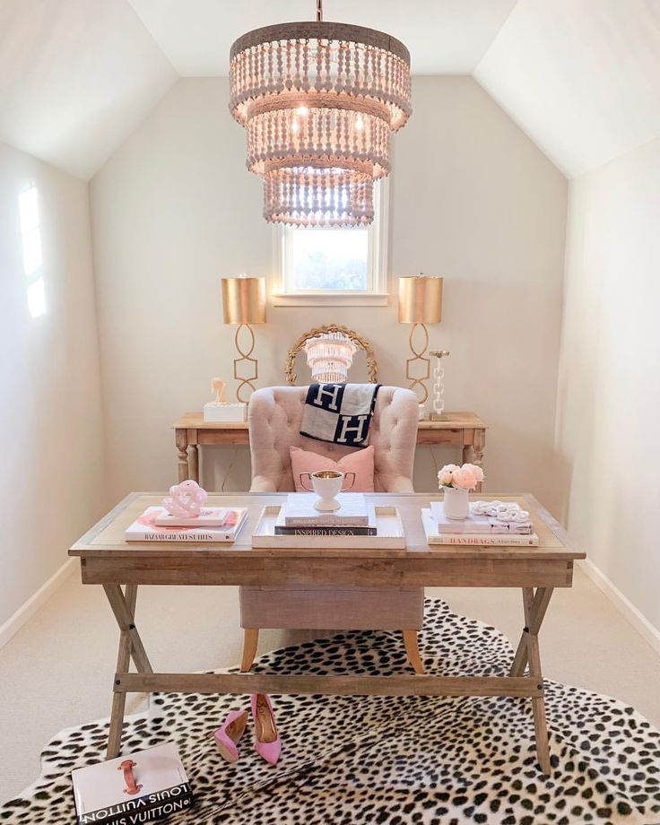 Feminine home office with a pink chair and leopard rug