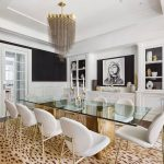 Glam with lots of black and brass and leopard-print rug in dining room