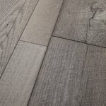 Restoration Collection® 8'' x 51'' x 12mm Oak Laminate Flooring in Steel