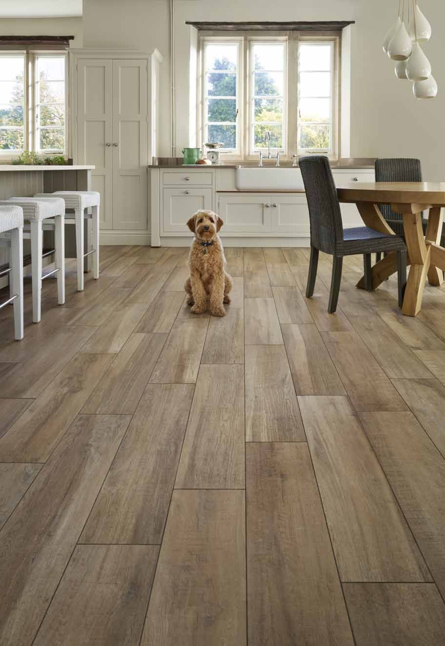 Running throughout the ground floor of this country house, the porcelain planks …