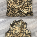 Sleeveless Zebra Print Top Silky black and gold zebra print button up top Evanda...