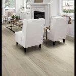 The extra-wide planks of this light-gray hardwood floor arent only on-trend they...